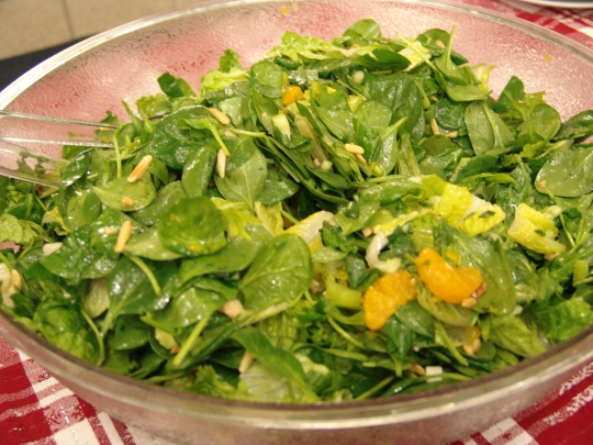Spinach salad with mandarin oranges, celery, green onions, sugared almonds, and an orange juice vinaigrette