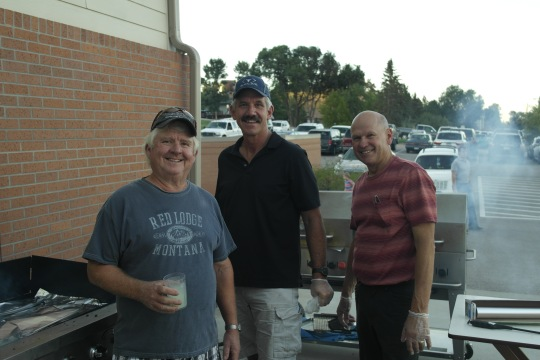 Jack, Randy, Dan and Perry (inside eating dinner?) endured the massive smoke and grilled up 480 mini burgers and 405 .3# burgers.
