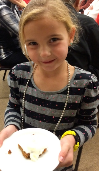 This little cutie was licking her frosting off her cake as she walked back to her table!