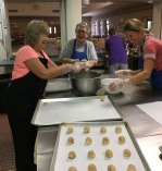 Vicki, Peg and Traci are sharing silly stories whilst rolling the snickerdoodles in cinnamon sugar.